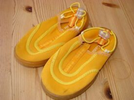 Surf/deck shoes. Size 8 (little kids) with adjustable toggle. VGC £1. Torquay.