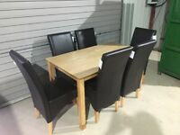 New. 5ft table with 6 brown leather chairs free delivery