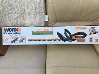 New WORX WG259E.9 20V Cordless Lithium-Ion Hedge Trimmer with Charger and Battery.