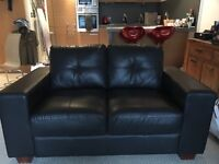 Faux black leather sofa, two seater for sale - bargain £25.00