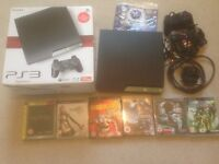 PS3 in box with games