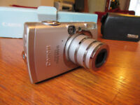 Canon Ixus950IS Digital Camera 8.3 million pixels in box with charger etc, case & spare battery