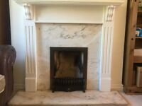 White mantle piece and marble surround