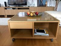 Well-kept coffee table. Oak finish. Lots of compartments.