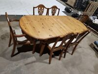 Farmhouse style pine dining table and 6 dining chairs