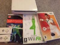 Nintendo Wii Console with 2 controllers and 3 games