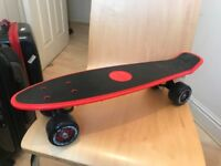 One nearly new skateboard (£10) plus new kneecap, elbowcap and gloves