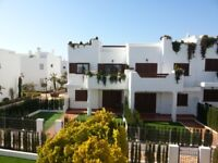 Two Bedroom 1st Floor Holiday Apartment in Almeria, Spain. Roof top solarium. 4 Pools. Beach nearby.