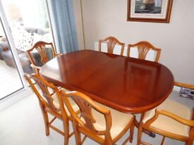 Bradley yew extendable dining table with six chairs and matching sideboard