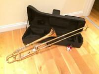 Tenor trombone with F attachment, carry case and straight mute