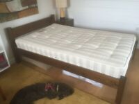 small double bed with bedside cabinet