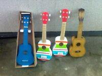 choice of four ukuleles