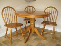 Kitchen table and chairs. Light oak finish. solid wood.