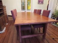 Solid pine extending dining table stained walnut and 6 fabric chairs. (can sit up to 12 persons)