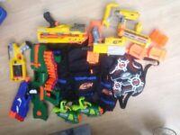 Job lot of Nerf guns and vests