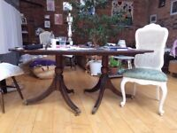 LARGE MAHOGANY ,SPLITS , DINING TABLE SOME MARKS TO THE TOP STILL VERY USABLE FREE LOCAL DELIVERY