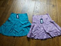 2 brand new M & S size 8 skirts and 3 brand new t shirts