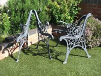 Two matching sets of cast iron chair ends in graphite grey