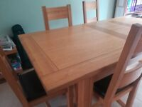 Plum Dining Table and six chairs by Halo