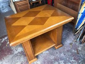 Solid occasional table with inlaid design