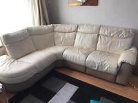 Cream leather corner sofa with recliner