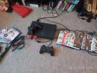 Playstation PS2 console, singstar mics Ps3 and ps2 plus games