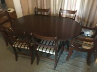 Large dark wood extending dining table with 6 chairs (including 2 carvers) £50 offers considered