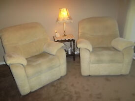 """Two lounge/arm chairs, """"G"""" plan brand,one full recliner, warm beige covered."""