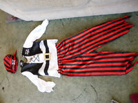 pirate outfit top, trousers, head scarf and eye patch age 7-8 years