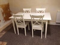 Extendable Ikea dining table with 4 chairs