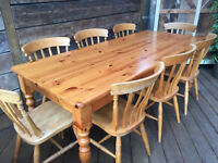 Very strong solid pine farmhouse dining table,7ft long with 8 traditional chairs, great condition