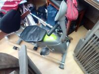 Compact sit back exercise bike