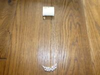 Brand new Accessorize Angel wing design necklace gold & diamante look.