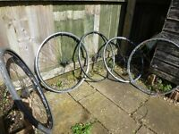 x5 Used racing bicycle wheels (perhaps suitable for indoor trainer or reconstruction)