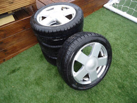 FORD15 INCH ALLOY WHEELS WITH BRAND NEW TYRES PUT ON THIS WEEKEND 4 STUD PUEGOT CITROEN RENAULT ALSO