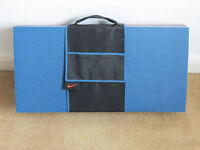 Folding yoga mat, 4 sections. 120 x 60cm unfolded. Separate holder. Never used.