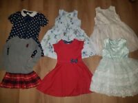 3-4 girls bundle. Including items from Next. Coat, waterproof outfit, dresses suitable for christmas