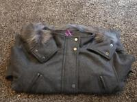 Brand new coat size 10