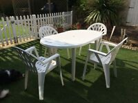 White Plastic Table and Four Chairs
