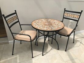 Mosaic table, two chairs with cushions and a mosaic bakers rack. All in excellent condition.