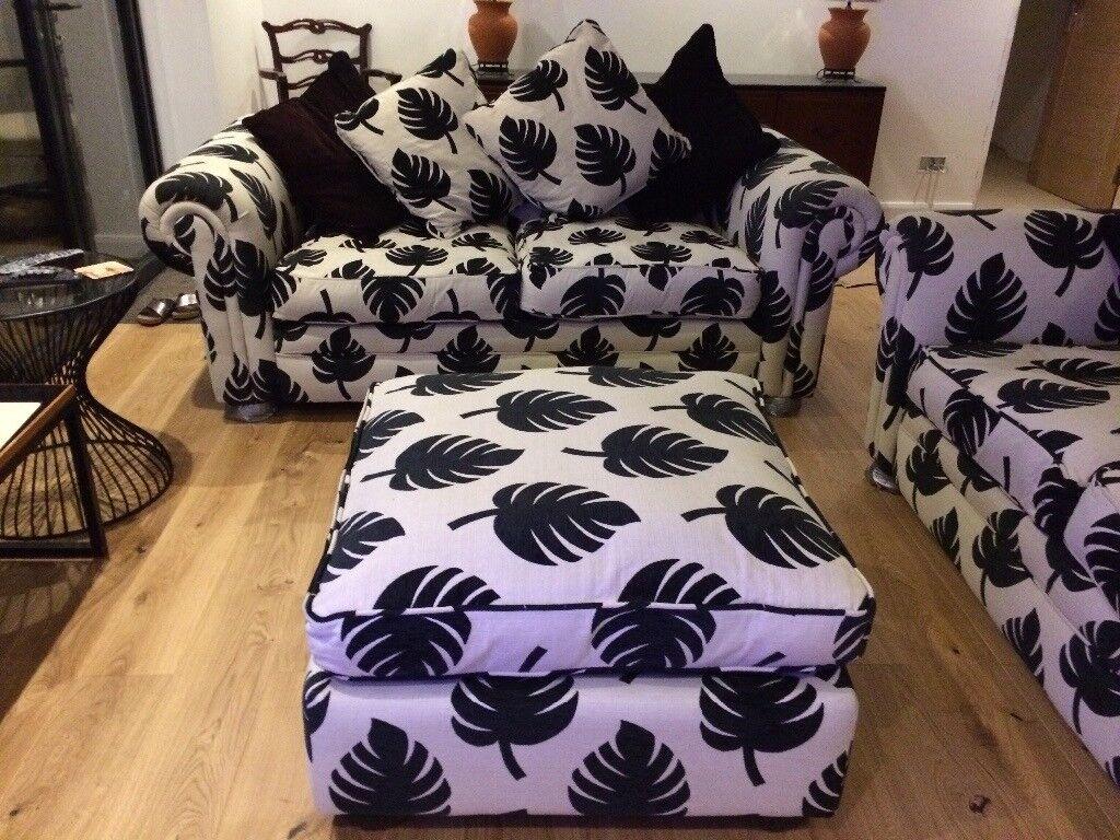 Cream and black sofas