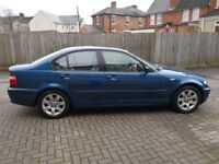 BMW 318I petrol automatic in metallic blue with two keys