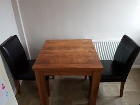 Next extending dining room table and 4 chairs