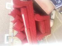 red patterned 3 seater, 2 seater and puffy stool