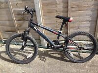 Boys 20 inch bike with front wheel suspension and 6 speed gripshift gears