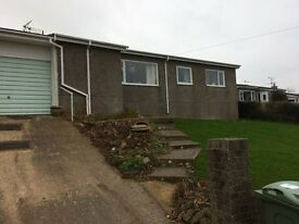 Renovated open plan two bed bungalow with superb country views.