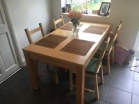 Extendable dining table with 4 chairs + cushions