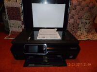 an HP Photosmart 5520 All-in-One Printer/Scanner/Copier