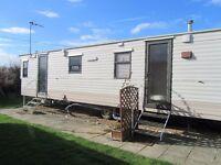 Holiday or 365 day use caravan on Mersea Island .