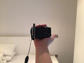 Sanyo Xacti FH 1 camera with 3 extra lithium ion batteries and Wide angle/Macro Fujiyama lens